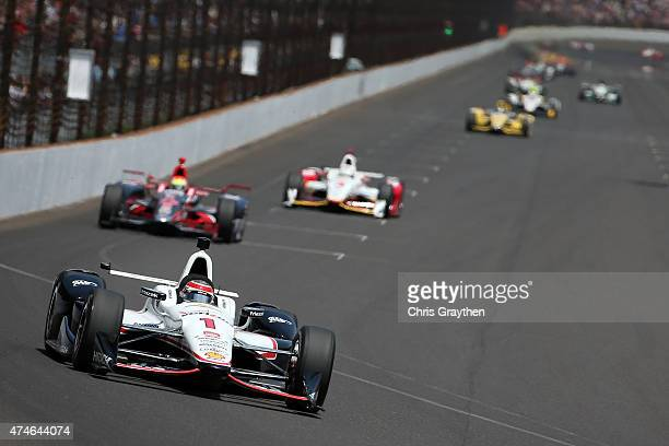 Will Power of Australia driver of the Penske Chevrolet Dallara leads a pack of cars during the 99th running of the Indianapolis 500 mile race at...