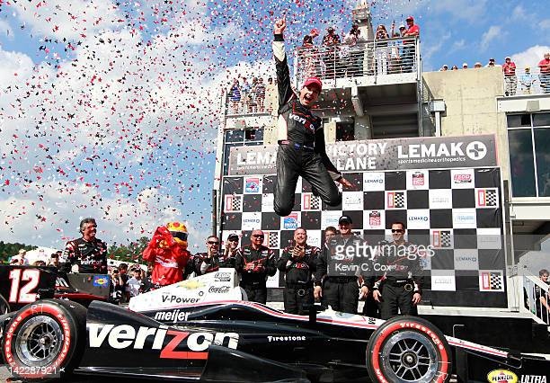 Will Power of Australia, driver of the Team Penske Chevrolet, celebrates after winning the IndyCar Series Honda Indy Grand Prix of Alabama presented...