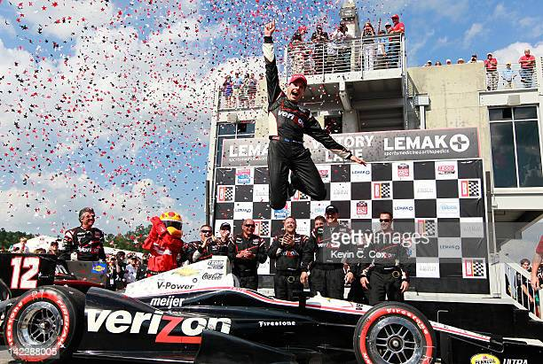 Will Power of Australia driver of the Team Penske Chevrolet celebrates after winning the IndyCar Series Honda Indy Grand Prix of Alabama presented by...