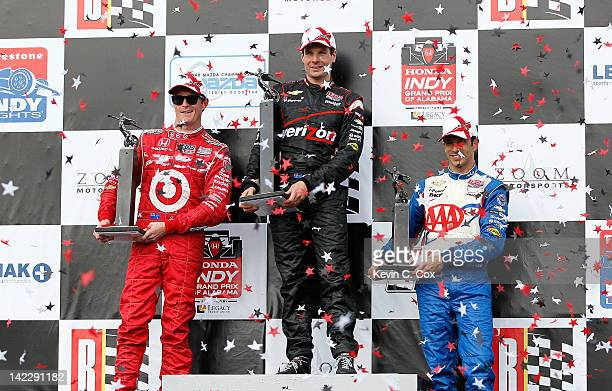 Will Power of Australia, driver of the Team Penske Chevrolet, Scott Dixon of New Zealand, driver of the Target Chip Ganassi Racing Honda, and Helio...