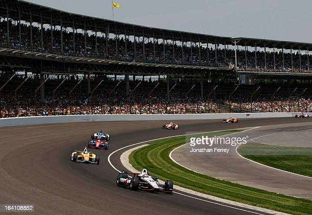 Will Power of Australia driver of the Verizon Team Penske Chevrolet leads cars through turn one during the IZOD IndyCar Series 96th running of the...