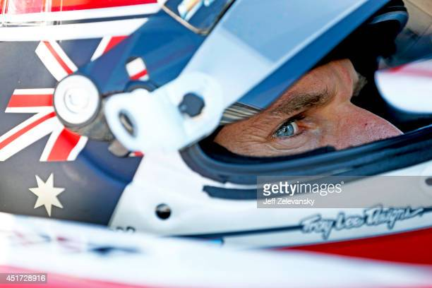 Will Power of Australia driver of the Verizon Team Penske Chevrolet sits in his car during practice for the Pocono INDYCAR 500 at Pocono Raceway on...