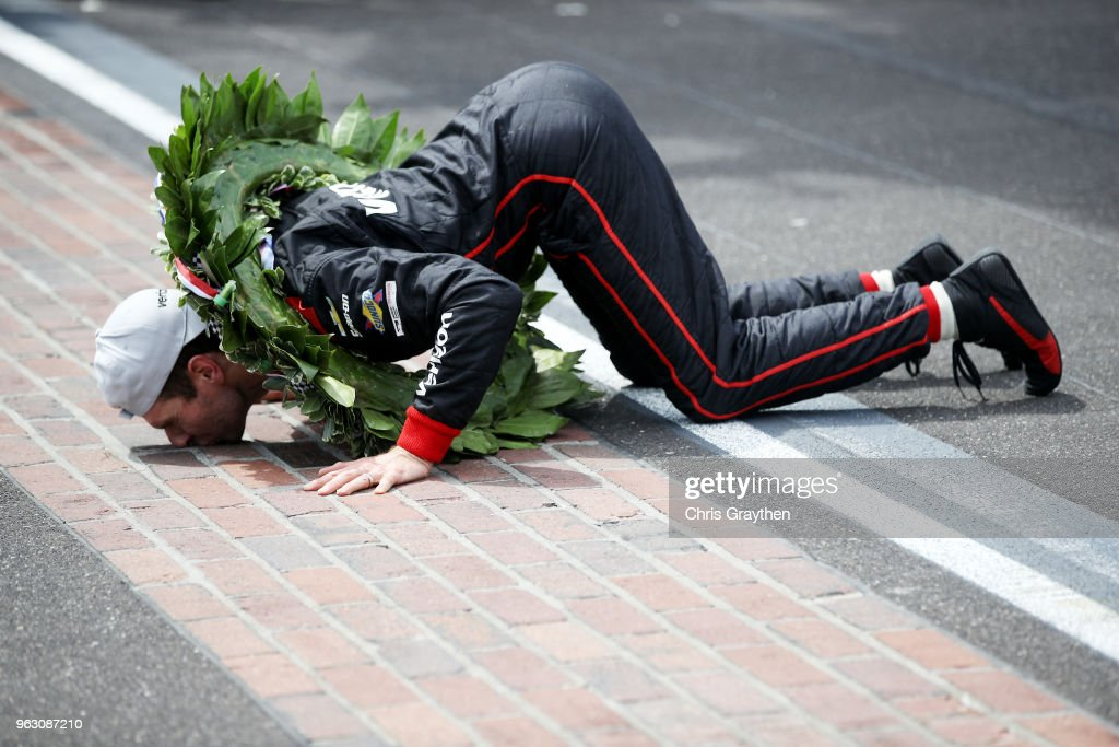 Will Power of Australia, driver of the #12 Verizon Team Penske Chevrolet celebrates by kissing the yard of bricks after winning the 102nd Running of the Indianapolis 500 at Indianapolis Motorspeedway on May 27, 2018 in Indianapolis, Indiana.