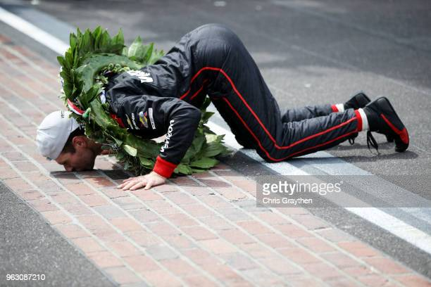 Will Power of Australia driver of the Verizon Team Penske Chevrolet celebrates by kissing the yard of bricks after winning the 102nd Running of the...