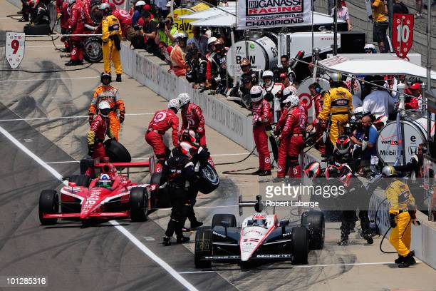 Will Power of Australia driver of the Verizon Team Penske Dallara Honda leaves a pit stop as his fueling hose breaks in front of Dario Franchitti of...
