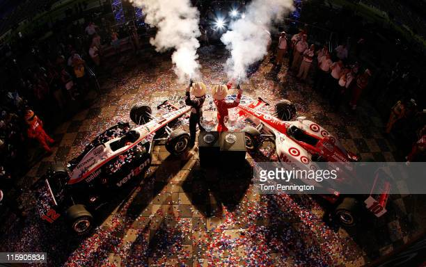 Will Power of Australia driver of the Verizon Team Penske Dallara Honda winner of race two and Dario Franchitti of Scotland driver of the Target Chip...