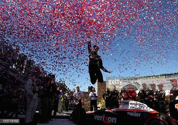 Will Power of Australia driver of the Verizon Team Penske Dallara Honda celebrates in the winners circle after he won the IZOD IndyCar Series Indy...