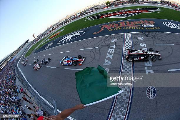 Will Power of Australia, driver of the Verizon Team Penske Dallara Chevrolet, leads Josef Newgarden, driver of the Strike/Sarah Fisher Hartman Racing...