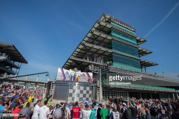 Will Power Scott Dixon and Ryan HunterReay accepting their INDYCAR Grand Prix trophies on May 13 at the Indianapolis Motor Speedway in Indianapolis...