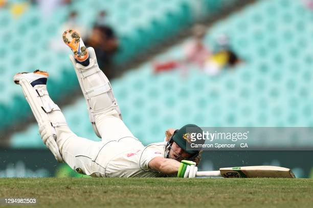 Will Pucovski of Australia avoids a runout during day one of the Third Test match in the series between Australia and India at Sydney Cricket Ground...