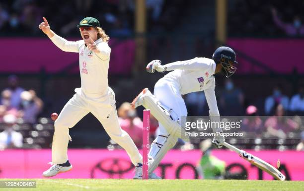 Will Pucovski of Australia celebrates after Jasprit Bumrah of India was run out by a direct throw from Marnus Labuschagne during day three of the...