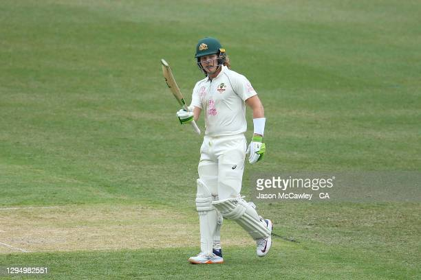 Will Pucovski of Australia celebrates after reaching his half century during day one of the 3rd Test match in the series between Australia and India...