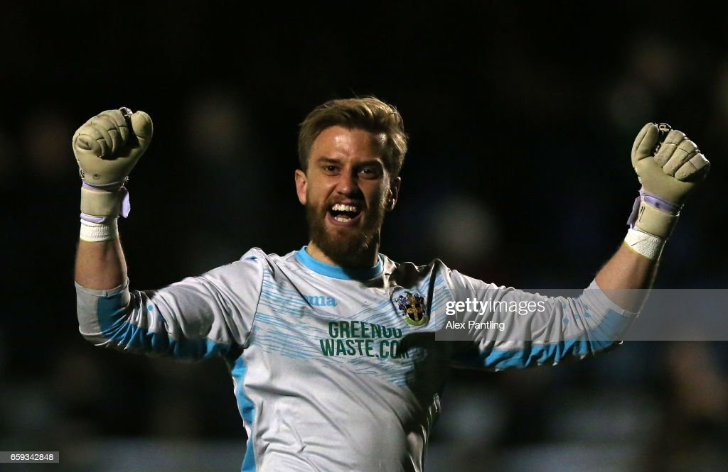Will Puddy of Sutton United celebrates after his side score their first goal during the Vanarama National League match between Sutton United and Lincoln City at Gander Green Lane on March 28, 2017 in Sutton, Greater London.