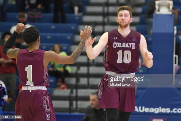 Will Rayman of the Colgate Raiders celebrates a shot with Jordan Burns during a college basketball game against the American University Eagles at...