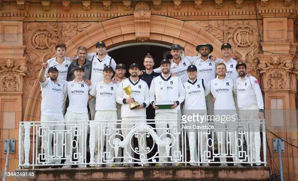 Will Rhodes and his Warwickshire teammates pose with the Bob Willis Trophy and County Championship after Day 4 of the Bob Willis Trophy Final between...