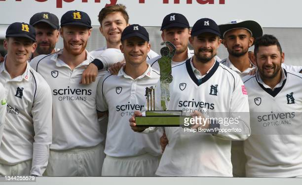 Will Rhodes holds the trophy with Liam Norwell, Sam Hain and Tim Bresnan after Warwickshire won the Bob Willis Trophy Final against Lancashire at...