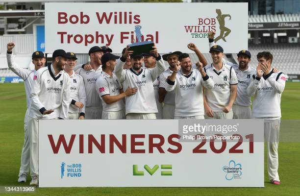 Will Rhodes lifts the trophy with the other Warwickshire players including Tim Bresnan after they won the Bob Willis Trophy Final against Lancashire...
