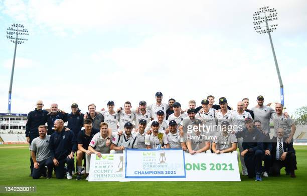 Will Rhodes of Warwickshire lifts the County Championship Trophy following Day Four of the LV= Insurance County Championship match between...