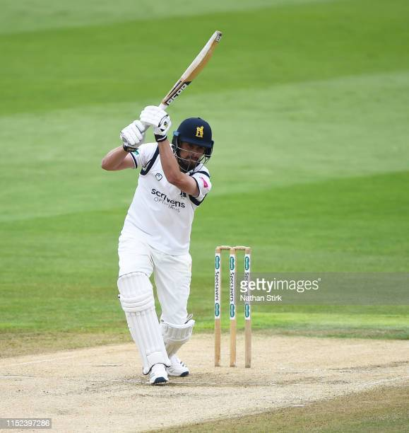 Will Rhodes of Warwickshire plays the cover drive shot while batting during the Specsavers County Championship Division One match between...