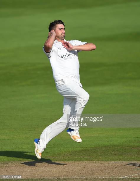 Will Rhodes of Warwickshire runs into bowl during the Specsavers County Championship Division Two match between Warwickshire and Durham at Edgbaston...