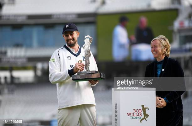 Will Rhodes of Warwickshire shares a joke with Bob Willis' wife Lauren Clark during Day 4 of the Bob Willis Trophy Final between Warwickshire and...
