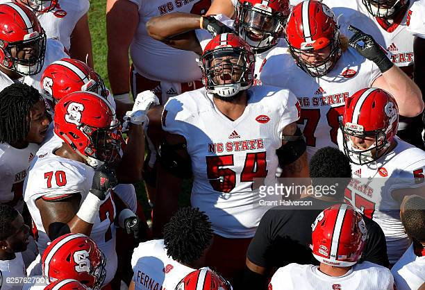 Will Richardson of the North Carolina State Wolfpack gets his team fired up before their game against the North Carolina Tar Heels at Kenan Stadium...