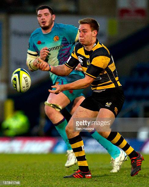 Will Robinson of Wasps passes the ball under pressure from James Phillips of Exeter during the LV= Cup match between London Wasps and Exeter Chiefs...