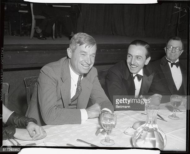 Will Rogers and Walt Disney enjoy a good laugh as they attend the party given in honor of Disney creator of Mickey Mouse and Silly Symphonies by the...