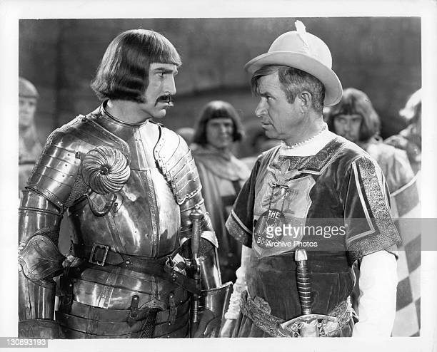 Will Rogers looking at unidentified knight in a scene from the film 'A Connecticut Yankee' 1931
