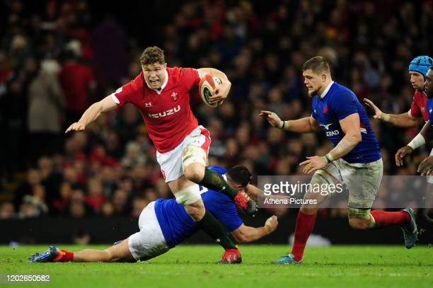 Will Rowlands of Wales evades the tackle of JeanBaptiste Gros of France during the Guinness Six Nations Championship Round 3 match between Wales and...