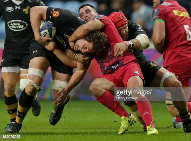 Will Rowlands of Wasps tackled by Dave Ward of Harlequins during the European Rugby Champions Cup match between Wasps and Harlequins at Ricoh Arena...