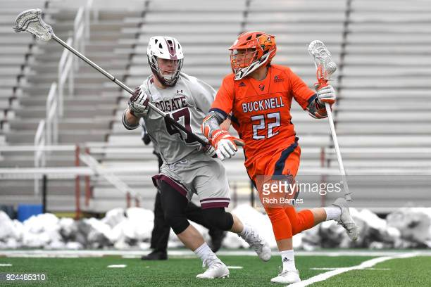 Will Sands of the Bucknell Bison dodges to the goal against the defense of Jack Donaghue of the Colgate Raiders during the first half at Andy Kerr...
