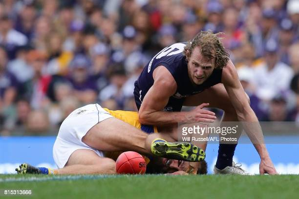 Will Schofield of the Eagles is tackled by David Mundy of the Dockers during the round 17 AFL match between the Fremantle Dockers and the West Coast...