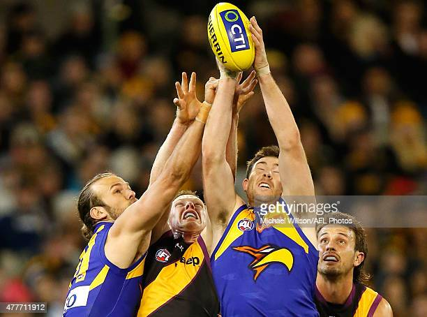 Will Schofield of the Eagles Jack Riewoldt of the Tigers Jeremy McGovern of the Eagles and Ivan Maric of the Tigers compete for the ball during the...