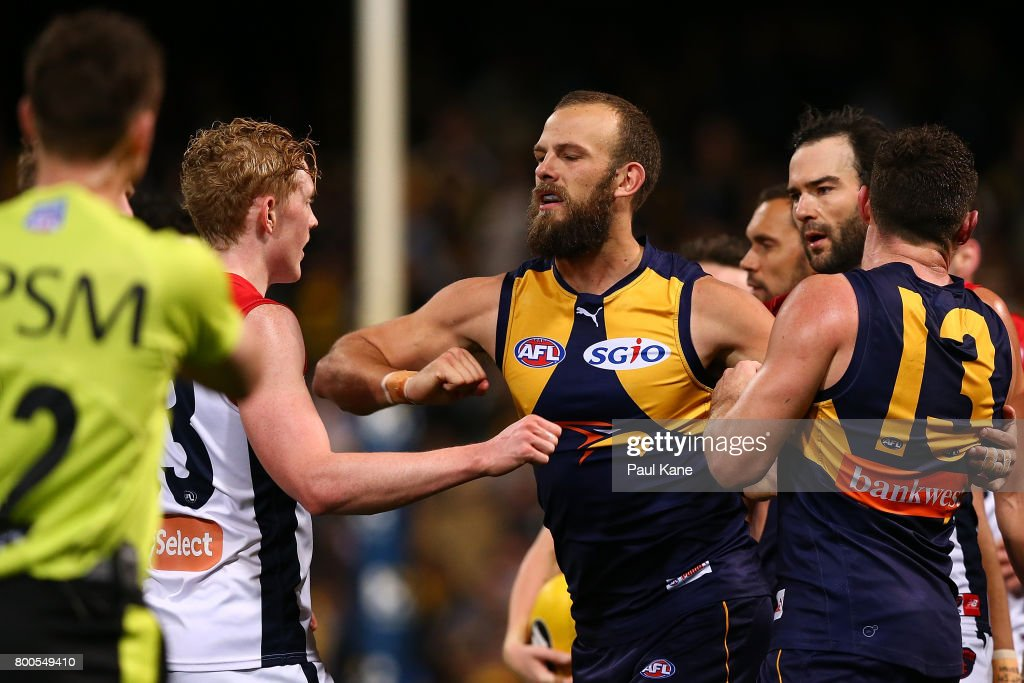 Will Schofield of the Eagles raises his elbow towards Clayton Oliver of the Demons during the round 14 AFL match between the West Coast Eagles and the Melbourne Demons at Domain Stadium on June 24, 2017 in Perth, Australia.