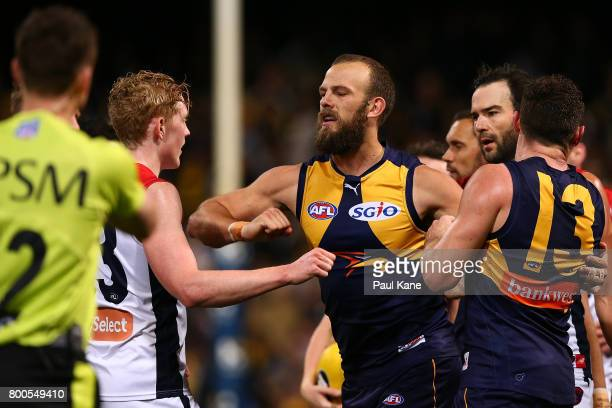 Will Schofield of the Eagles raises his elbow towards Clayton Oliver of the Demons during the round 14 AFL match between the West Coast Eagles and...