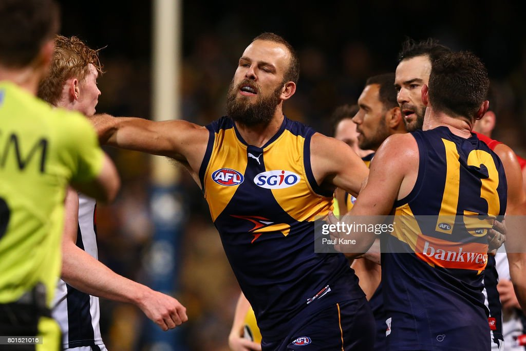 Will Schofield of the Eagles raises his forearm towards Clayton Oliver of the Demons at the end of the second quarter during the round 14 AFL match between the West Coast Eagles and the Melbourne Demons at Domain Stadium on June 24, 2017 in Perth, Australia.
