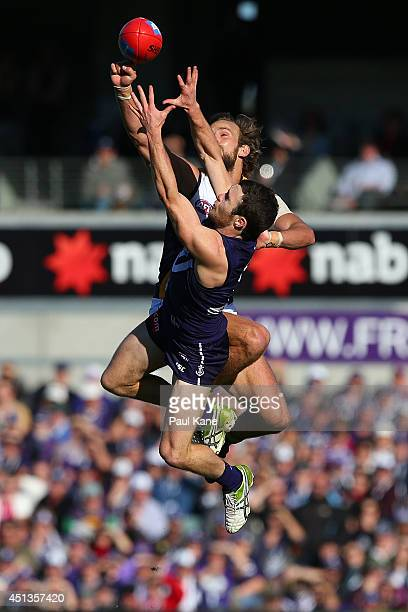 Will Schofield of the Eagles spoils the mark for Hayden Ballantyne of the Dockers during the round 15 AFL match between the Fremantle Dockers and...
