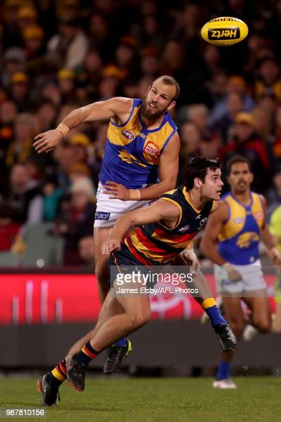 Will Schofield of the Eagles tackles Darcy Fogarty of the Crows during the 2018 AFL round15 match between the Adelaide Crows and the West Coast...