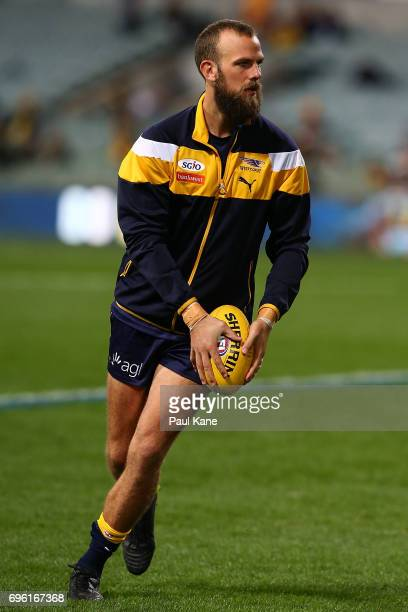 Will Schofield of the Eagles warms up before the round 13 AFL match between the West Coast Eagles and the Geelong Cats at Domain Stadium on June 15...