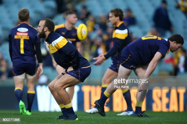 Will Schofield of the Eagles warms up during the round 14 AFL match between the West Coast Eagles and the Melbourne Demons at Domain Stadium on June...