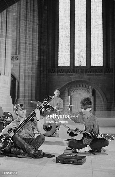Will Sergeant Pete De Freitas and Ian McCulloch of British band Echo and the Bunnymen perform on stage in Liverpool Cathedral on August 18 1983