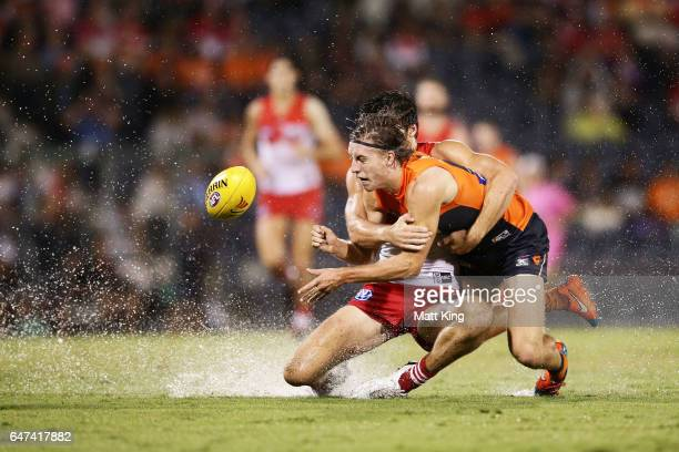 Will Setterfield of the Giants is challenged by Jordan Dawson of the Swans during the 2017 JLT Community Series AFL match between the Greater Western...