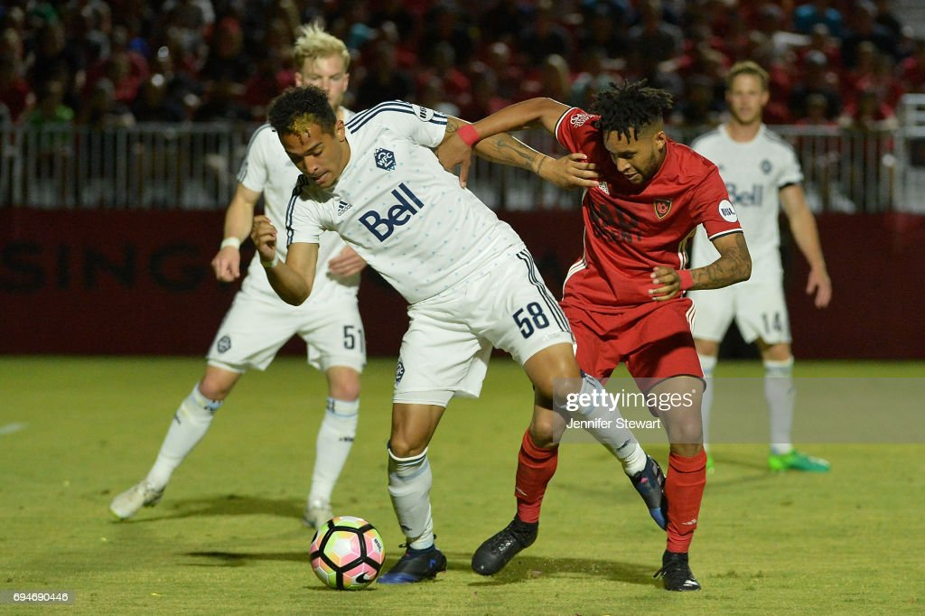 Will Seymore #58 of Vancouver Whitecaps II dribbles by Amadou Dia #19 of Phoenix Rising FC in the second half of the match at Phoenix Rising Soccer Complex on June 10, 2017 in Phoenix, Arizona. The Phoenix Rising FC won 2-1.
