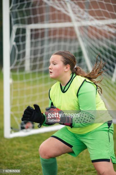 will she save the football? - try scoring stock pictures, royalty-free photos & images