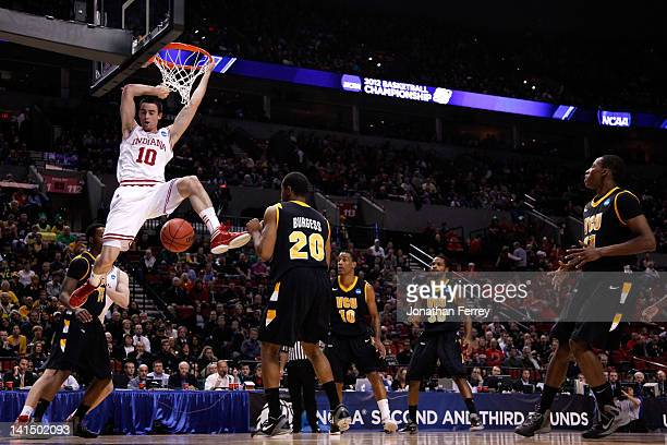 Will Sheehey of the Indiana Hoosiers goes up to dunk the ball against the Virginia Commonwealth Rams in the first half during the third round of the...