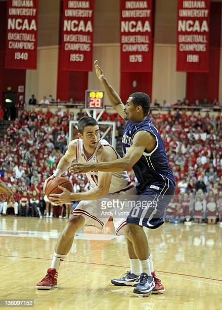 Will Sheehey of the Indiana Hoosiers looks to pass the ball while defended by Glen Andrews of the Howard Bison during the game at Assembly Hall on...