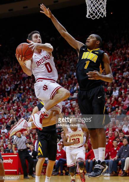 Will Sheehey of the Indiana Hoosiers shoots the ball as Melsahn Basabe of the Iowa Hawkeyes defends at Assembly Hall on February 27 2014 in...
