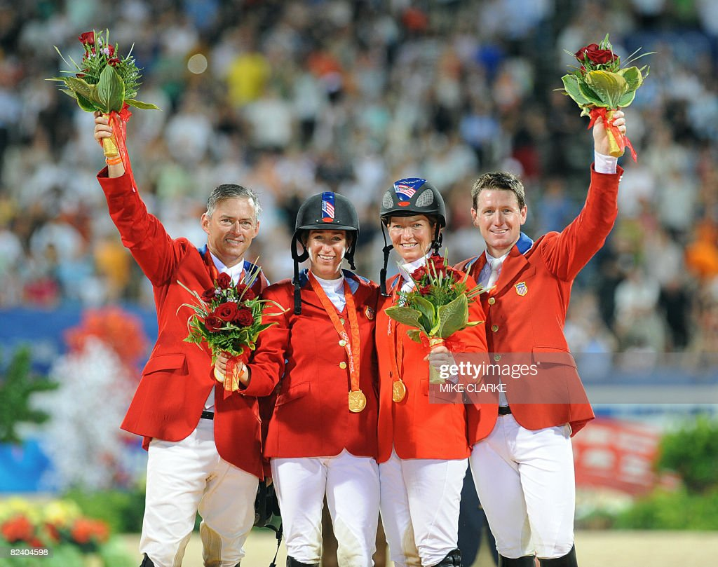 Will Simpson, Laura Kraut, Beezie Madden and Mclain Ward of the US celebrate winning gold on the podium of the Olympic equestrian show-jumping - Team on August 18, 2008 in Hong Kong. Canada took silver and Norway claimed bronze.