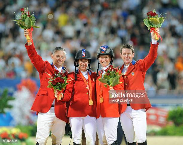 Will Simpson Laura Kraut Beezie Madden and Mclain Ward of the US celebrate winning gold on the podium of the Olympic equestrian showjumping Team on...